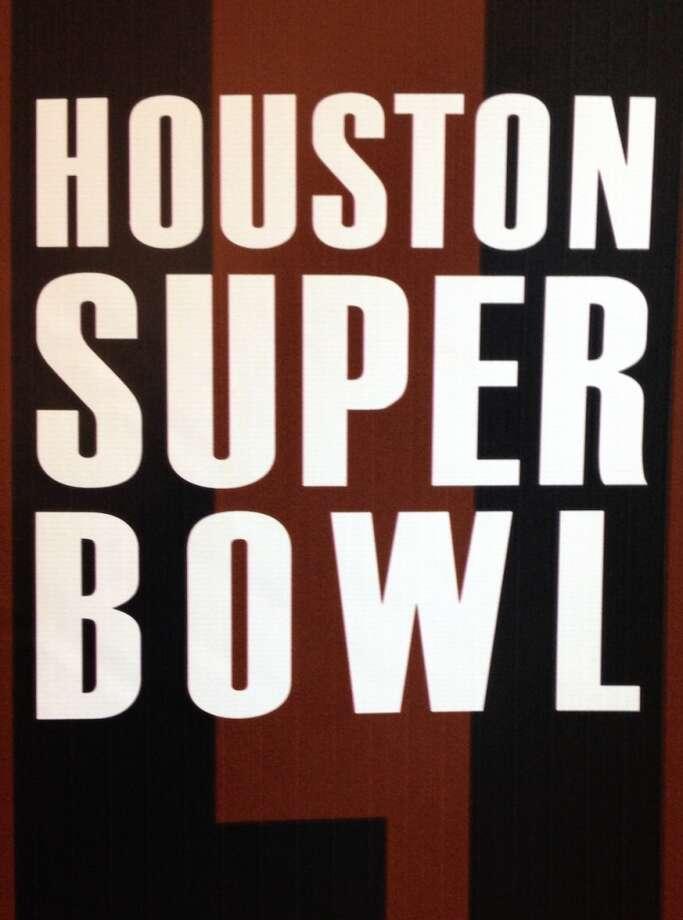 A Super Bowl logo on backdrop at a Super Bowl LI presser at One Park Place.