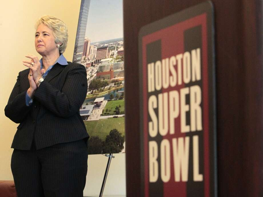 Houston Mayor Annise Parker claps during a Wednesday news conference at One Park Place.