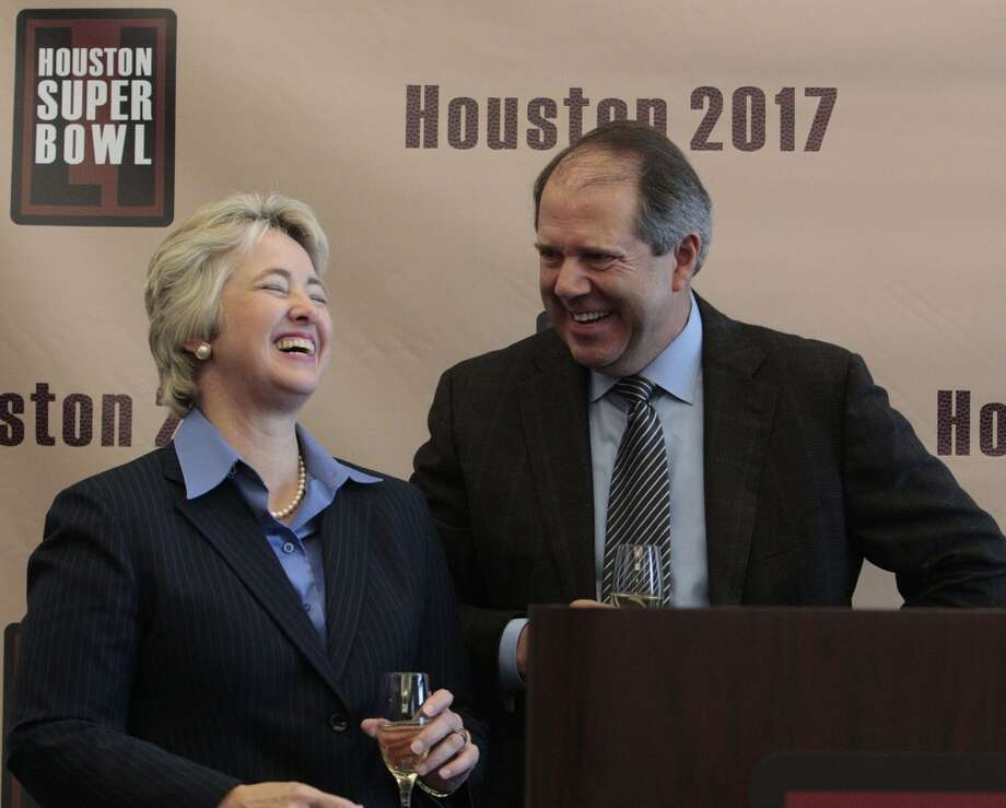 Houston Mayor Annise Parker prepares to make a toast with Ric Campo, chairman of Houston First, during Wednesday's news conference.