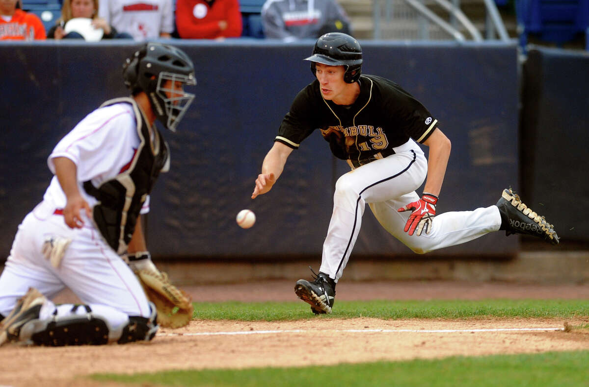 Trumbull's Jake Levison prepares to dive into homeplate as Greenwich catcher John Dreher tries to make the tag, during FCIAC Baseball Championship semi-final action at the Ballpark at Harbor Yard in Bridgeport, Conn. on Wednesday May 22, 2013. Levison made it to the plate safely.