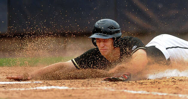 Trumbull's Jake Levison dives head first into homeplate to score, during FCIAC Baseball Championship semi-final action against Greenwich at the Ballpark at Harbor Yard in Bridgeport, Conn. on Wednesday May 22, 2013. Photo: Christian Abraham / Connecticut Post
