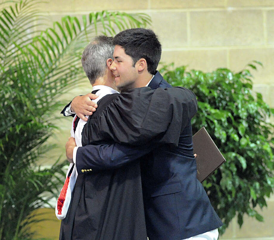 At left, Brunswick School Headmaster, Thomas Philip, hugs graduating senior, Nicholas Kono, during the Brunswick School Graduation at the school in Greenwich, Wednesday, May 22, 2013. Photo: Bob Luckey / Greenwich Time