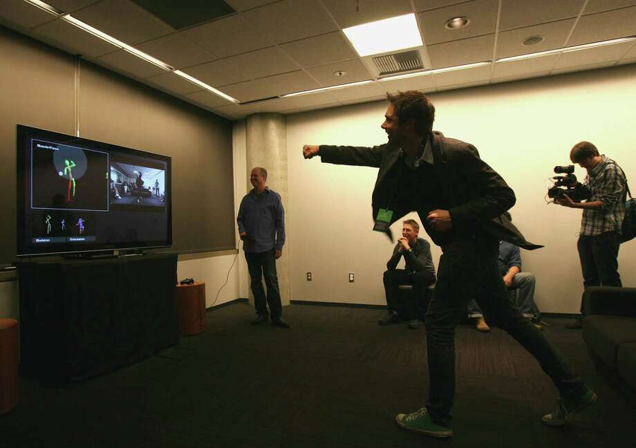 A volulnteer punches to show how the new Kinect sensor registered movement on Tuesday, May 21, during the Xbox One unveiling at Microsoft's campus in Redmond, Wa. Photo: Aubrey Cohen, Seattlepi.com