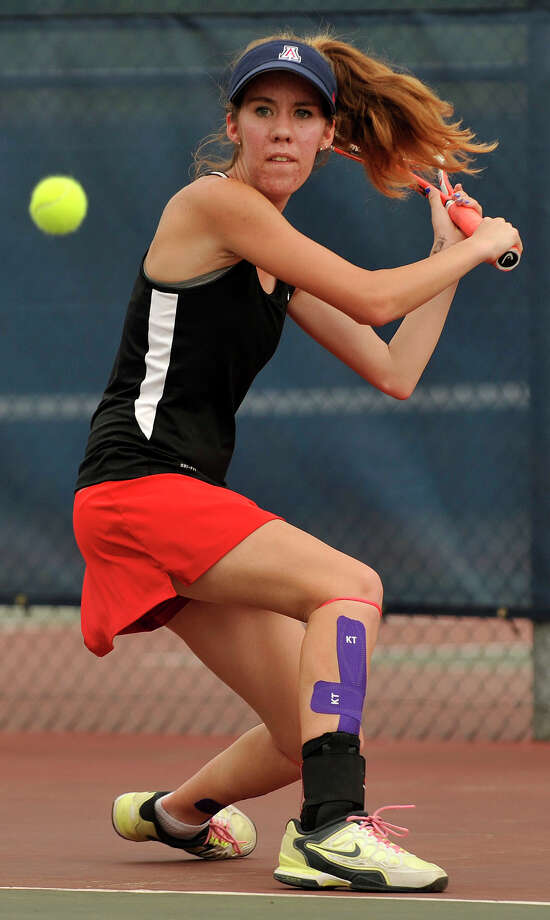 New Canaan's Jensen Lee returns the ball to Fairfield Ludlowe's Lindsey Evans, not pictured, during their FCIAC championship singles match at Wilton High School on Wednesday, May 22, 2013. Photo: Jason Rearick / Stamford Advocate