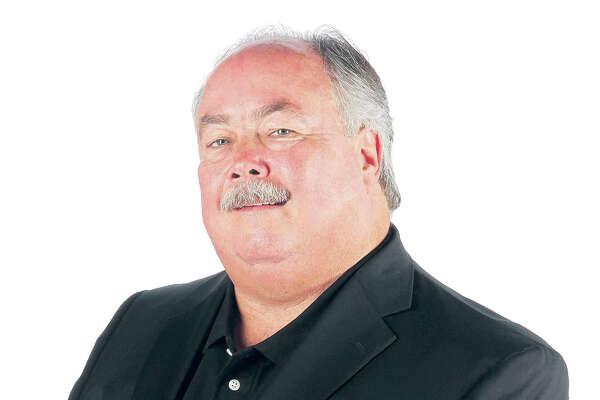 Houston Chronicle editorial staffs John McClain Thursday, Aug. 16, 2012, in Houston.  ( James Nielsen / Chronicle )