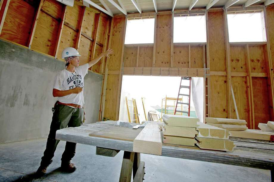 Contractor Shannon Bryant with Tend Building talks about how the new classrooms at the Monarch School will be environmental friendly.