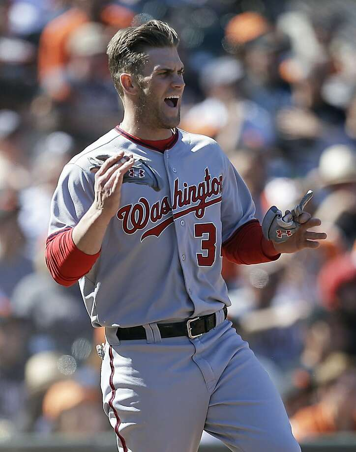 Washington Nationals' Bryce Harper celebrates after scoring against the San Francisco Giants in the 10th inning of a baseball game Wednesday, May 22, 2013, in San Francisco. Harper scored on a hit by Nationals' Ian Desmond. (AP Photo/Ben Margot) Photo: Ben Margot, Associated Press