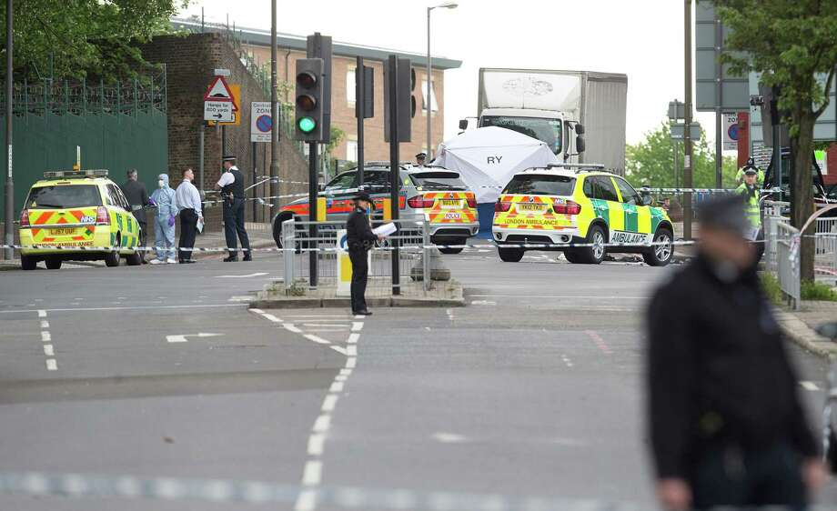 A tent is erected near the scene of an attack in Woolwich southeast  London Wednesday, May, 22, 2013. British officials said one person has died and at least two people have been wounded in an attack in southeast London. Scotland Yard said officers responded to reports of an assault Wednesday afternoon in the London neighbourhood of Woolwich. London Ambulance service said one man was found dead at the scene and two other men were taken to the hospital, with one in serious condition. (AP Photo/Alastair Grant) Photo: Alastair Grant