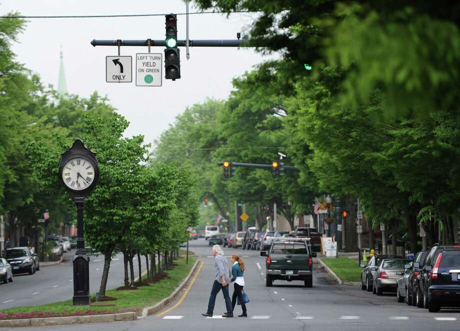 People cross Main Street in Danbury, Conn. the evening of Wednesday, May 22, 2013.  Figures released by the U.S. Census Bureau state that Danbury is the fastest-growing city in Connecticut.  The state of Connecticut grew by roughly 13,700 residents between July 2010 and July 2012, remaining the nation's 29th most populated state. Photo: Tyler Sizemore / The News-Times
