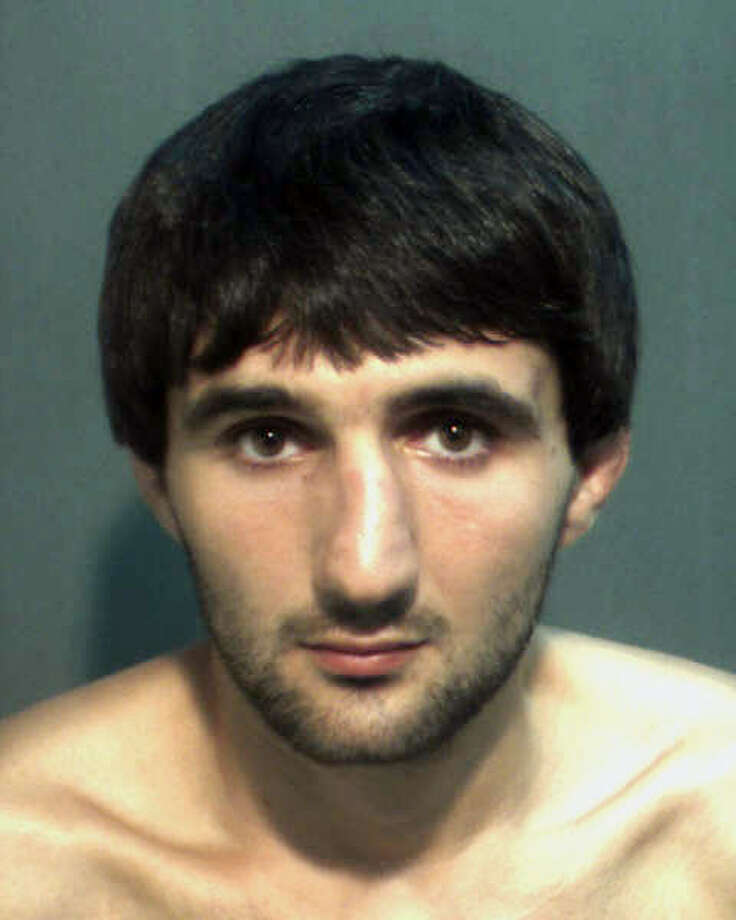 In this May 4, 2013 police mug provided by the Orange County Corrections Department in Orlando, Fla., shows Ibragim Todashev after his arrest for aggravated battery in Orlando. Todashev, who was being questioned in Orlando by authorities in the Boston bombing probe, was fatally shot Wednesday, May 22, 2013 when he initiated a violent confrontation, FBI officials said. (AP Photo/Orange County Corrections Department)