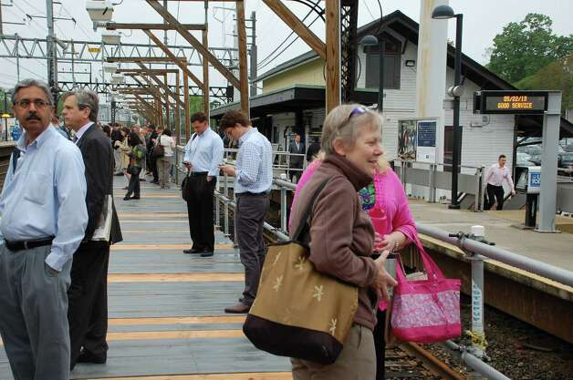 The New York-bound passenger platform at the Fairfield Center Railroad Station was typically full Wednesday morning with the restoration of Metro-North service. Photo: Jarret Liotta / Fairfield Citizen contributed