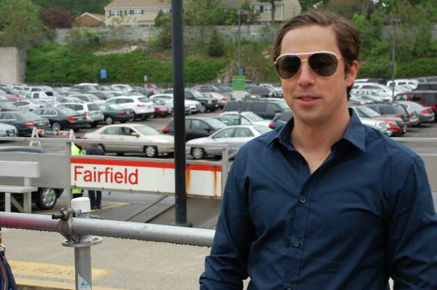 "Mike Beck of Fairfield waits for a train to Stamford on Wednesday morning. ""It's awesome,"" he said of the quick restoration of service after Friday's train collision. ""We thought it was going to be seven to 10 days."" Photo: Jarret Liotta / Fairfield Citizen contributed"