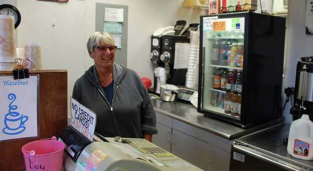 Sue Montgomery of Chat-n-Chew coffee shop was glad the two-day shut down of the shop ended Wednesday with the restoration of rail service. Photo: Jarret Liotta / Fairfield Citizen contributed