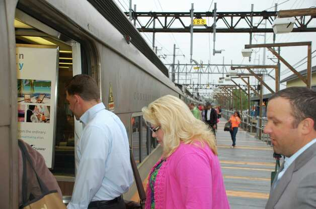 Rail passengers boarded Metro-North trains at the downtown Fairfield station Wednesday morning for the first time since service disruptions caused by the Friday train collision in Bridgeport. Photo: Jarret Liotta / Fairfield Citizen contributed