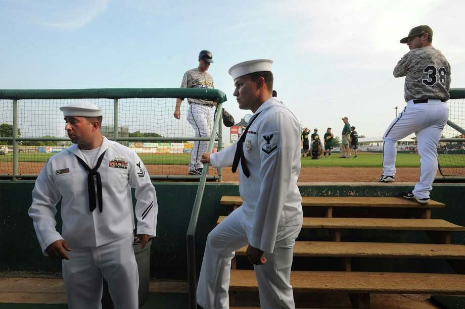 Greg Lackey, left, and D.J. Kagebein of the Navy Color Guard gather in the San Antonio Missions dugout during Military Appreciation Night before the Missions' Texas League game against the Arkansas Travelers at Wolff Stadium on Wednesday, May, 22, 2013. Photo: Billy Calzada, San Antonio Express-News / San Antonio Express-News