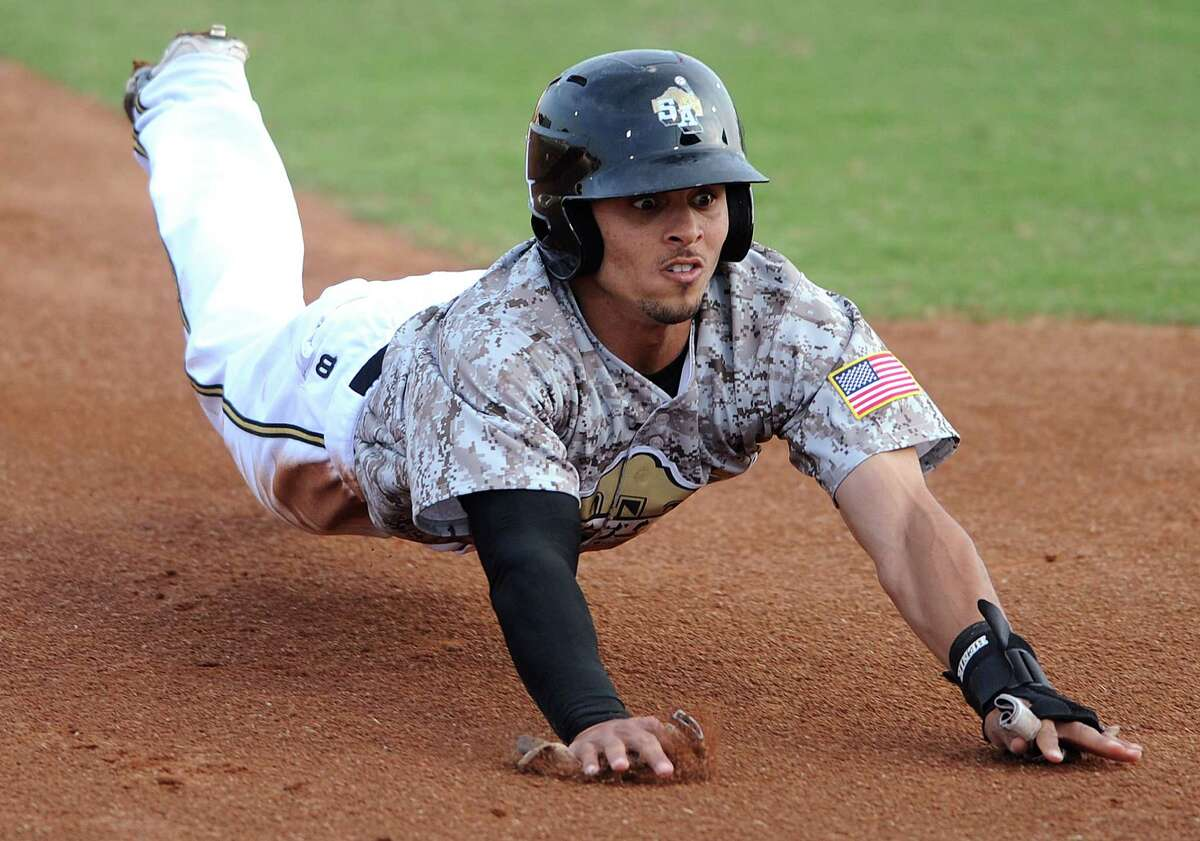 The Missions' Rico Noel slides into third, only to be tagged out to end the first inning of play against the Arkansas Travelers during Texas League action at Wolff Stadium on Wednesday, May, 22, 2013.