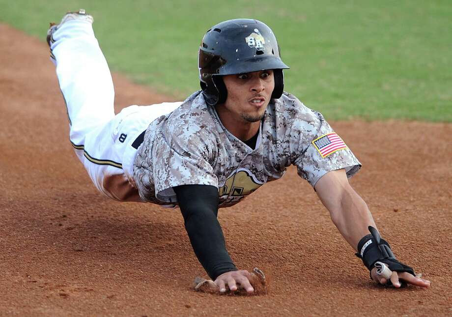 The Missions' Rico Noel slides into third, only to be tagged out to end the first inning of play against the Arkansas Travelers during Texas League action at Wolff Stadium on Wednesday, May, 22, 2013. Photo: Billy Calzada, San Antonio Express-News / San Antonio Express-News