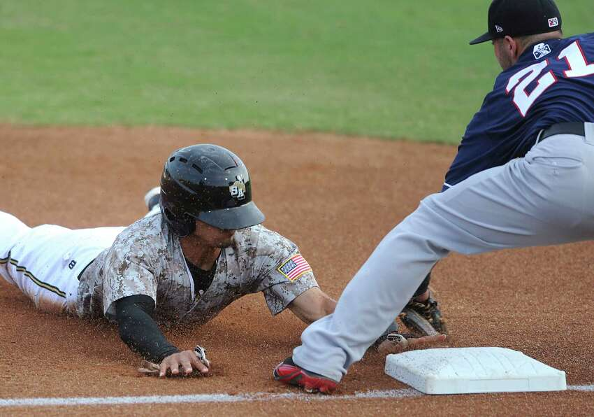 The Missions' Rico Noel is tagged out by third baseman Kaleb Cowert of the Arkansas Travelers to end the first inning of play against the Arkansas Travelers during Texas League action at Wolff Stadium on Wednesday, May, 22, 2013.