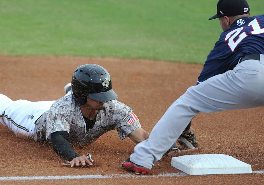 The Missions' Rico Noel is tagged out by third baseman Kaleb Cowert of the Arkansas Travelers to end the first inning of play against the Arkansas Travelers during Texas League action at Wolff Stadium on Wednesday, May, 22, 2013. Photo: Billy Calzada, San Antonio Express-News / San Antonio Express-News
