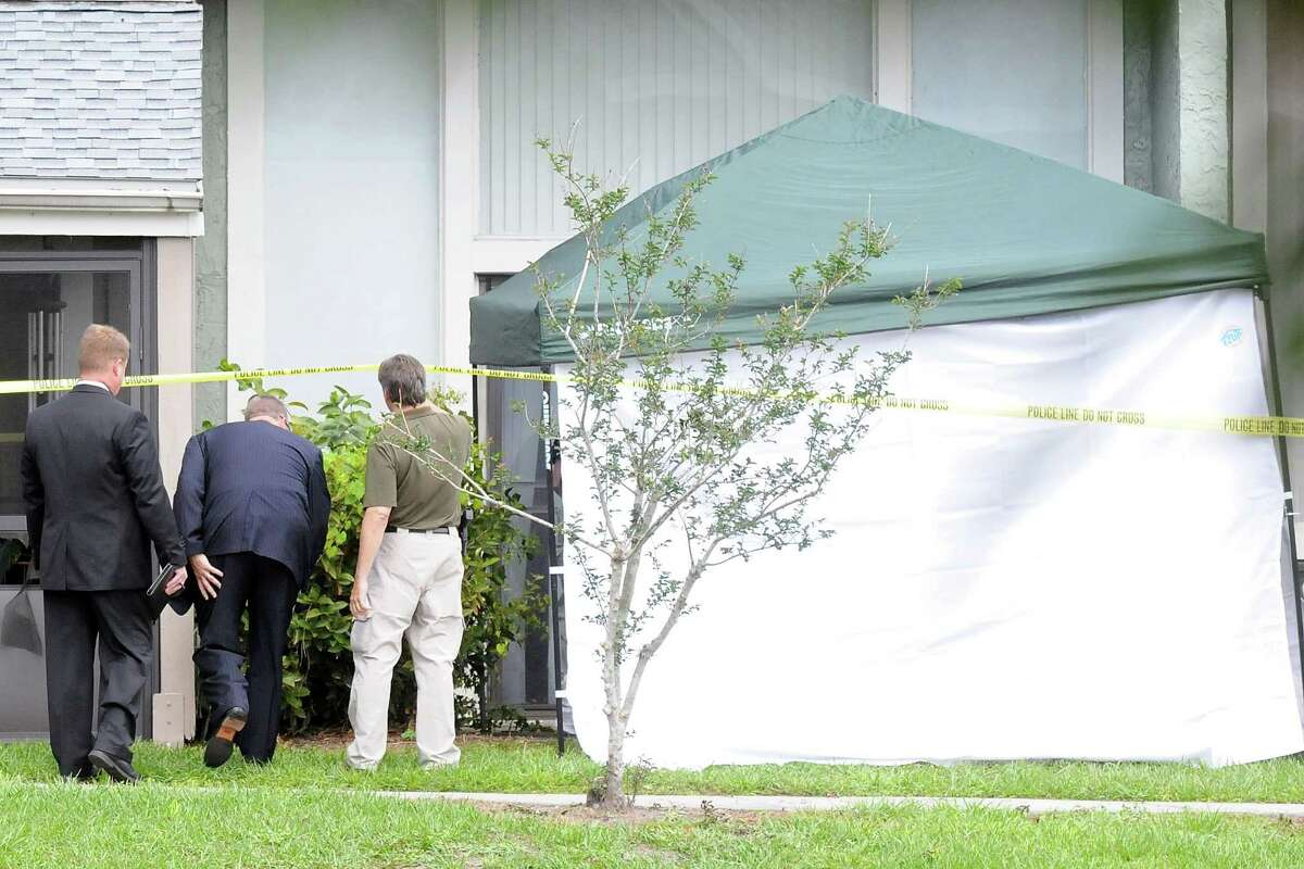 Federal Bureau of Investigation (FBI) agents arrive to the apartment where a suspected friend of the Boston bombers was shot and killed by FBI on May 22, 2013 in Orlando, Florida. Ibragim Todashev was being questioned by the FBI about his ties to the Boston Marathon bombing suspects when he was killed after attacking the agent.