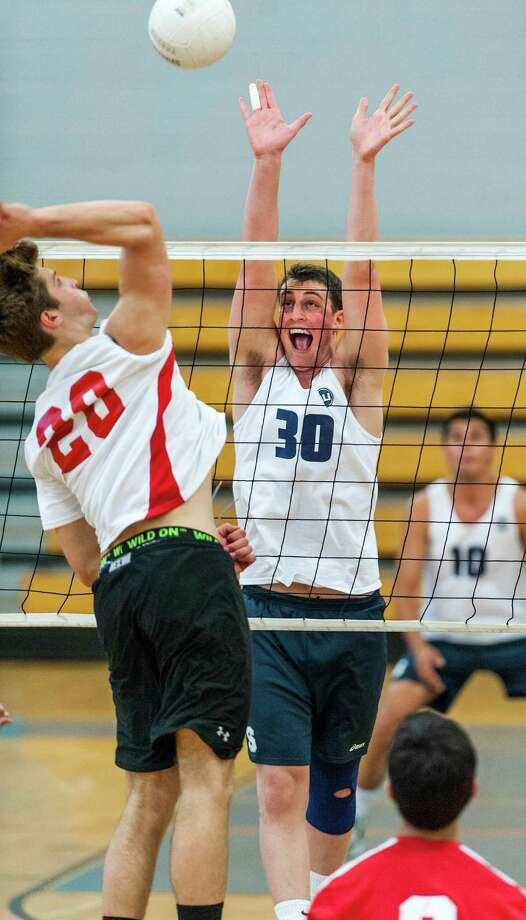 Staples high school's Todd Goldstein goes up to block a spike by Greenwich high school's Zak Steiner during an FCIAC boys volleyball semifinal match played at Fairfield Ludlowe high school, Fairfield, CT on Wednesday May 22nd, 2013. Photo: Mark Conrad / Stamford Advocate Freelance