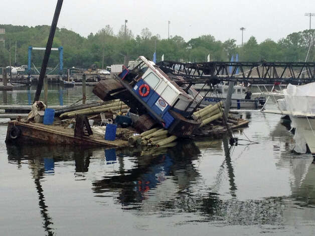 A crane on a barge in Stamford Harbor toppled over and landed on a 47-foot powerboat on Wednesday, May 22, 2013. Photo: John Nickerson
