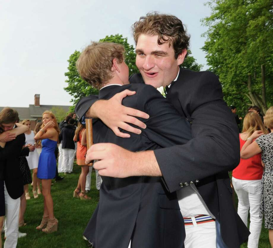 At right, Alexander Coopersmith, 18, of Greenwich, smiles while hugging a fellow graduate after the Brunswick School Graduation at the school in Greenwich, Wednesday, May 22, 2013. Coopersmith said he will be attending the University of North Carolina in the fall. Photo: Bob Luckey / Greenwich Time