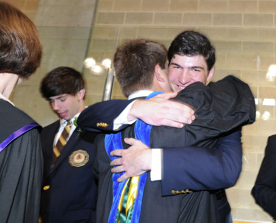At right, Brunswick School graduating senior, Chris Brown, 18, of Greenwich, smiles while getting a hug during the Brunswick School Graduation at the school in Greenwich, Wednesday, May 22, 2013. Brown said he will be attending Dartmouth College in the fall. Photo: Bob Luckey / Greenwich Time