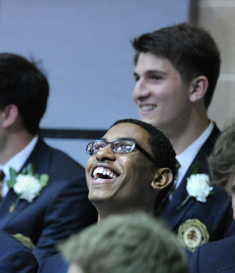 Brunswick School graduating senior Jordan Reid of Mount Vernon, N.Y., laughs during a speech at the Brunswick School Graduation in Greenwich, Wednesday, May 22, 2013. Photo: Bob Luckey / Greenwich Time