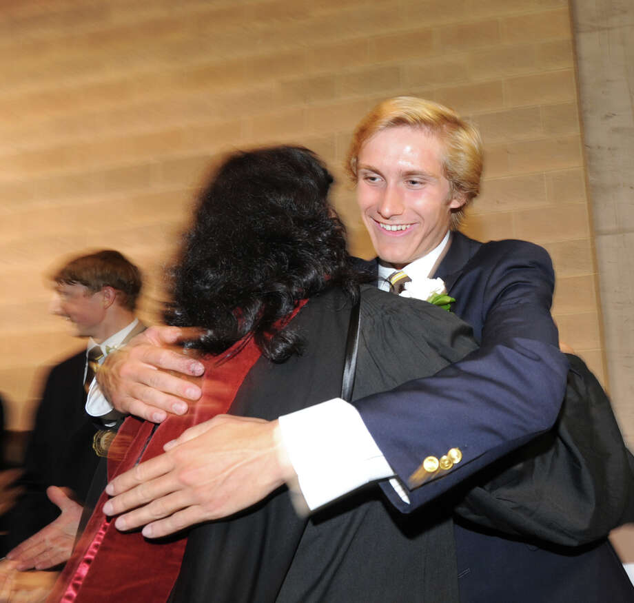 At right, Brunswick School graduating senior, Matthew Podlesak, 18, of New Canaan, gets a hug during the Brunswick School Graduation at the school in Greenwich, Wednesday, May 22, 2013. Podlesak said he will be attending Harvard in the fall. Photo: Bob Luckey / Greenwich Time