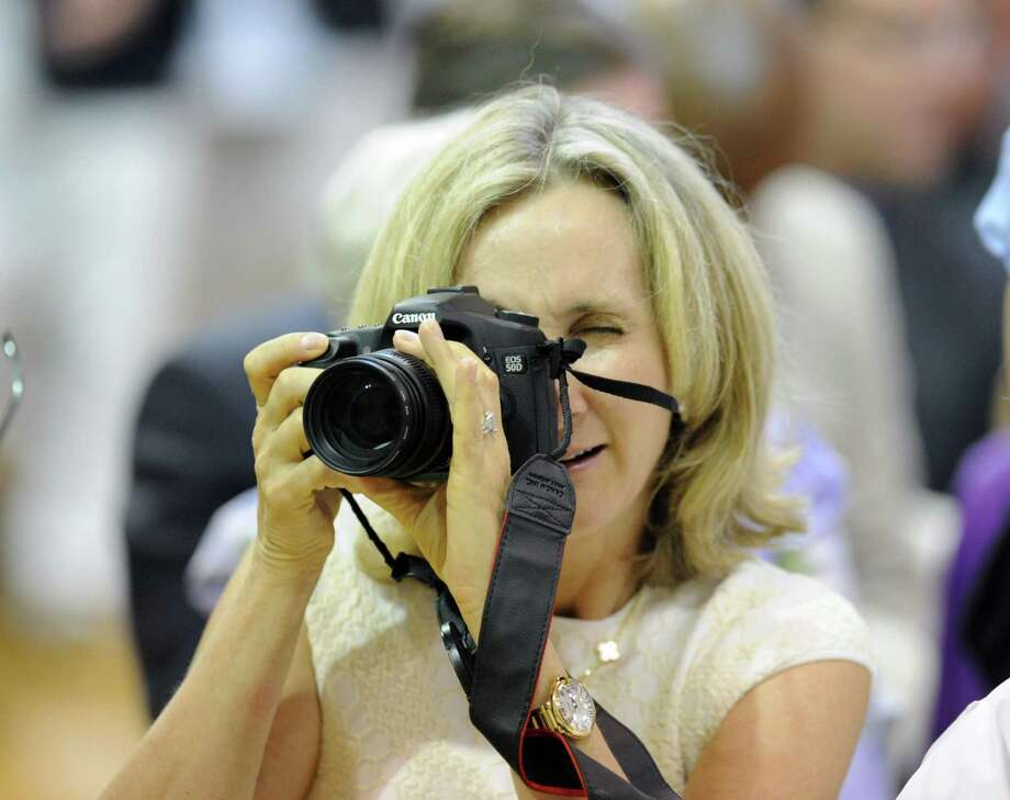 Rhonda Sherwood of Darien takes a photo during the Brunswick School Graduation at the school in Greenwich, Wednesday, May 22, 2013. Sherwood's son, John William Sherwood, graduated from the school and will be attending the University of Michigan in the fall. Photo: Bob Luckey / Greenwich Time