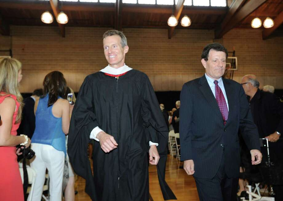 At left, Brunswick School Headmaster, Thomas Philip, with New York Times columnist, Nicholas Kristof, during the start of the Brunswick School Graduation at the school in Greenwich, Wednesday, May 22, 2013. Photo: Bob Luckey / Greenwich Time