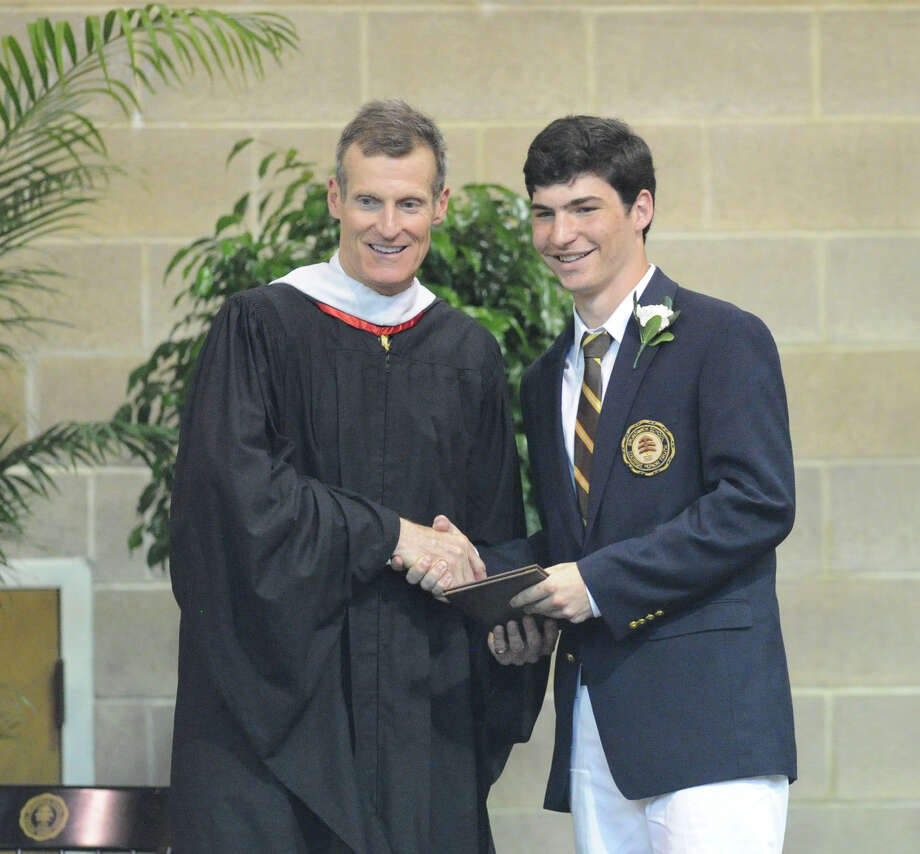 At left, Brunswick School Headmaster, Thomas Philip, shakes the hand of graduating senior Chris Brown, 18, of Greenwich, during the Brunswick School Graduation at the school in Greenwich, Wednesday, May 22, 2013. Photo: Bob Luckey / Greenwich Time