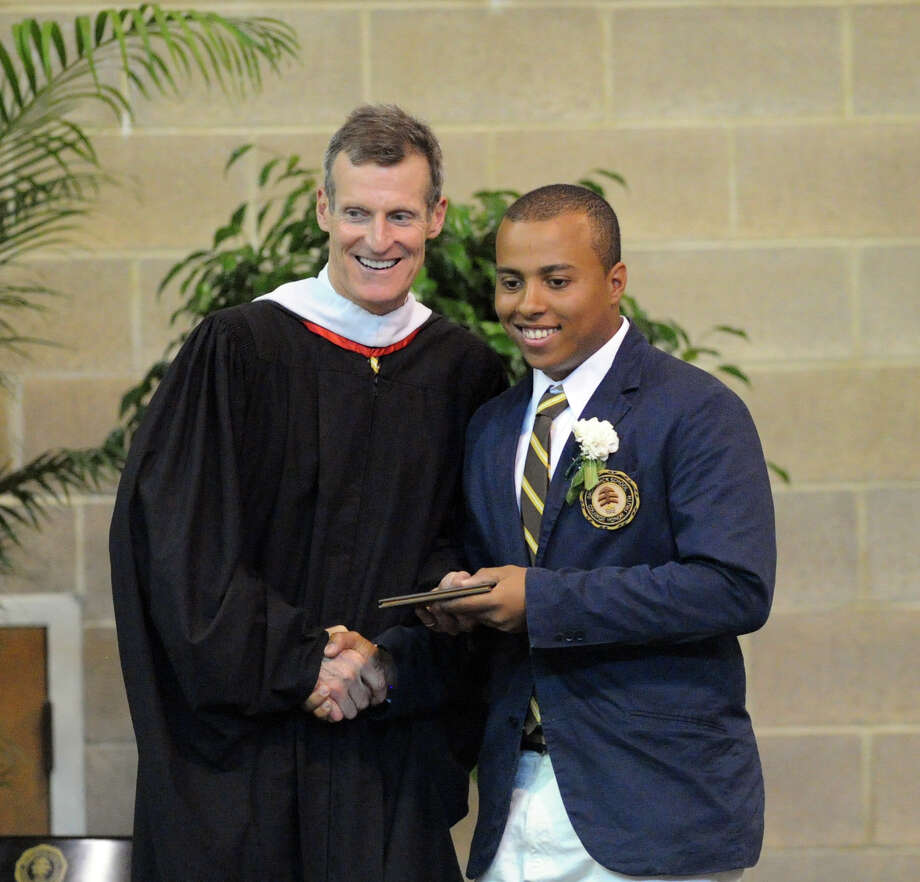 At left, Brunswick School Headmaster, Thomas Philip, shakes the hand of graduating senior Justin Cedeno during the Brunswick School Graduation at the school in Greenwich, Wednesday, May 22, 2013. Photo: Bob Luckey / Greenwich Time