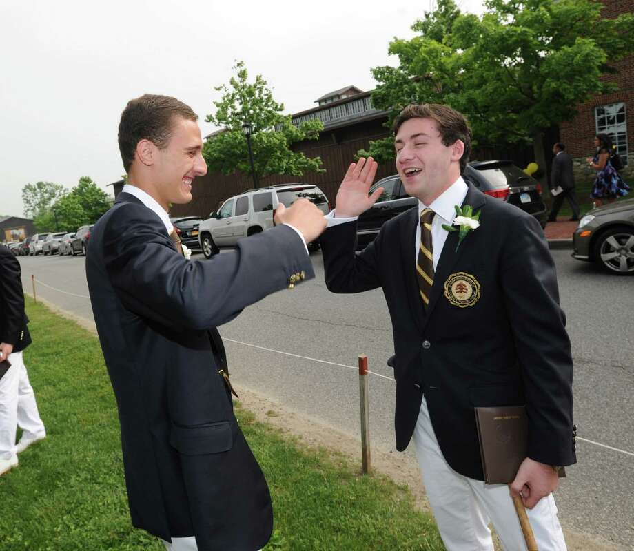 Brunswick School graduating seniors, Will Floersheimer, left, and Sam Zuckert, both 18 and both Greenwich residents, with their Brunswick School diplomas, high-five after the Brunswick School Graduation at the school in Greenwich, Wednesday, May 22, 2013. The pair said they both will be attending the University of Southern California. Photo: Bob Luckey / Greenwich Time