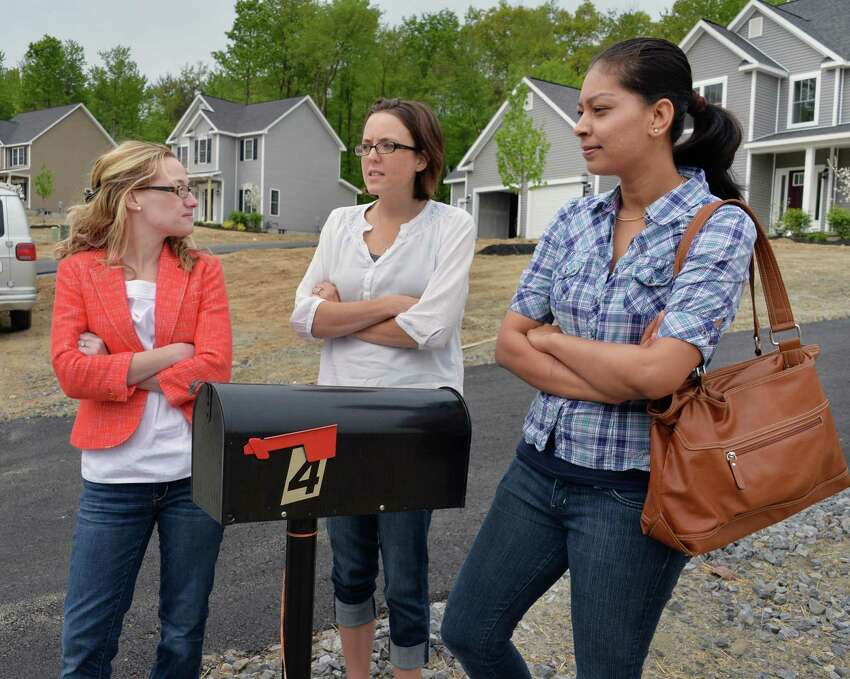 Ridge Wood Drive residents, from left, Lauren Berger, Ashley Putz and Payal Patel outside a home in Halfmoon, N.Y., Wednesday, May 15, 2013. The trio were among neighbors fighting for mail service. (John Carl D'Annibale / Times Union)
