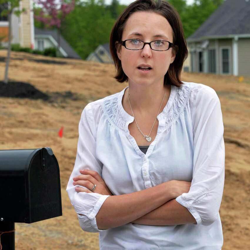 Ridge Wood Drive resident Ashley Putz outside her home in Halfmoon, N.Y., Wednesday, May 15, 2013. The post office had told her that her neighborhood would not have mail service, due to new regulations. (John Carl D'Annibale / Times Union)