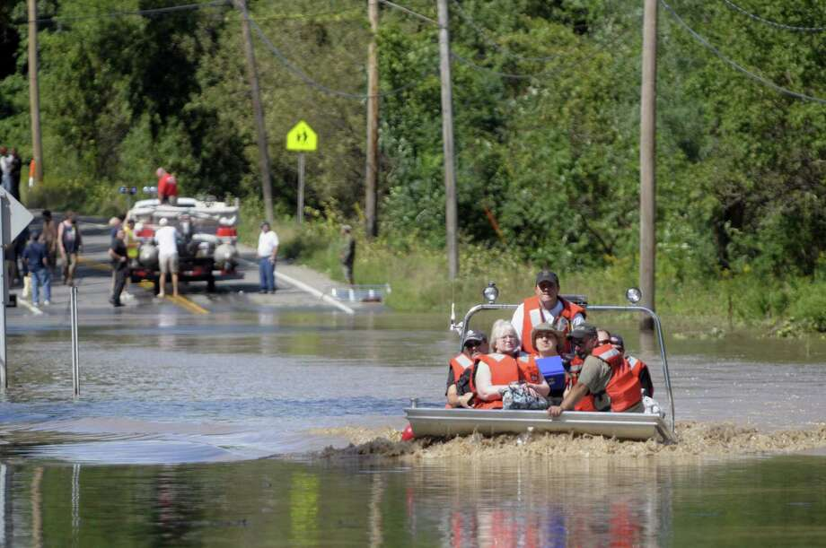 Area firefighters use a boat to evacuate residents of Rotterdam Junction on Monday, Aug. 29, 2011 due to rising flood waters of the Mohawk River.   (Paul Buckowski / Times Union archive) Photo: Paul Buckowski / 00014438B
