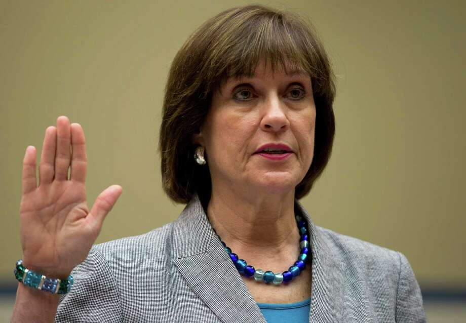 IRS official Lois Lerner is sworn in on Capitol Hill in Washington, Wednesday, May 22, 2013, before the House Oversight Committee hearing to investigate the extra scrutiny IRS gave to Tea Party and other conservative groups that applied for tax-exempt status. Lerner told the committee she did nothing wrong and then invoked her constitutional right to not answer lawmakers' questions. (AP Photo/Carolyn Kaster) Photo: Carolyn Kaster