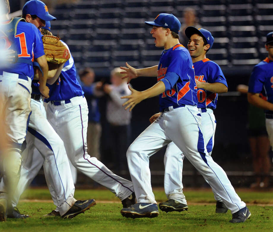Danbury celebrates its win over Fairfield Ludlowe, during FCIAC Baseball Championship semi-final action at the Ballpark at Harbor Yard in Bridgeport, Conn. on Wednesday May 22, 2013. Photo: Christian Abraham / Connecticut Post
