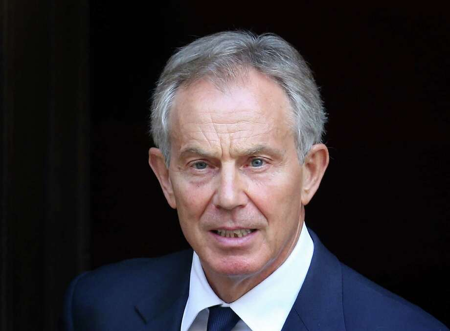 LONDON, ENGLAND - MAY 28:  Former Prime Minister Tony Blair leaves The Royal Courts of Justice by a side door after giving evidence to The Leveson Inquiry on May 28, 2012 in London, England. This phase of the inquiry into the culture, practice and ethics of the press in the United Kingdom is looking at the relationship between the press and politicians. The inquiry, which may take a year or more to complete, comes in the wake of the phone hacking scandal that saw the closure of The News of The World newspaper in 2011.  (Photo by Peter Macdiarmid/Getty Images) Photo: Peter Macdiarmid, Staff / 2012 Getty Images