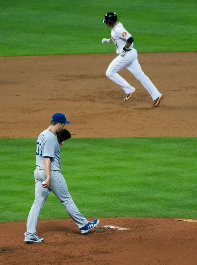Astros left fielder J.D. Martinez, top, rounds the bases after hitting a two-run home run.