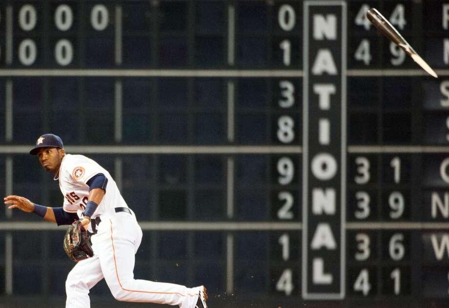 Astros third baseman Jimmy Paredes ducks away from a piece of broken bat.