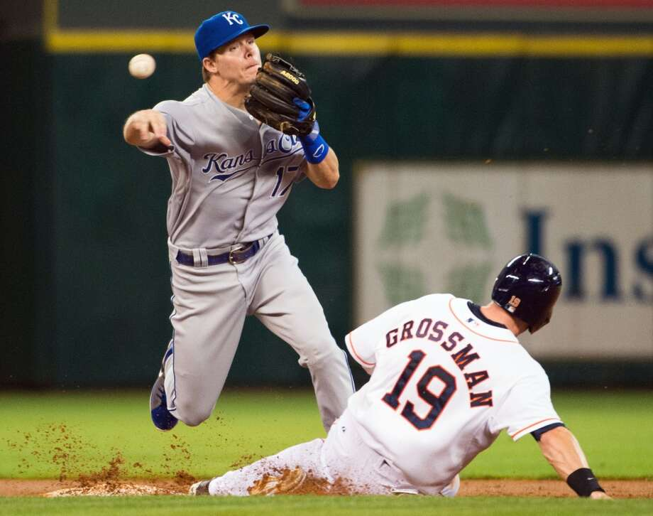 Royals second baseman Chris Getz makes the relay over Astros center fielder Robbie Grossman.