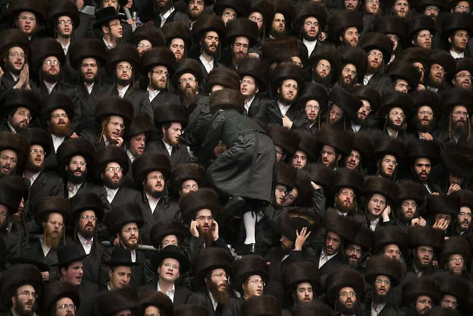JERUSALEM, ISRAEL - MAY 22:  Tens of thousands of Ultra-Orthodox Jews of the Belz Hasidic Dynasty take part in the wedding ceremony of Rabbi Shalom Rokach, the Grandson of the Belz Rabbi to Hana Batya Pener, early morrning of May 22, 2013. in Jerusalem, Israel. Some 25,000 Ultra-Orthodox Jews participated in one of the biggest weddings of the of Ultra-Orthodox Jewish community in the past few years.  (Photo by Uriel Sinai/Getty Images)  *** BESTPIX *** Photo: Uriel Sinai, Getty Images