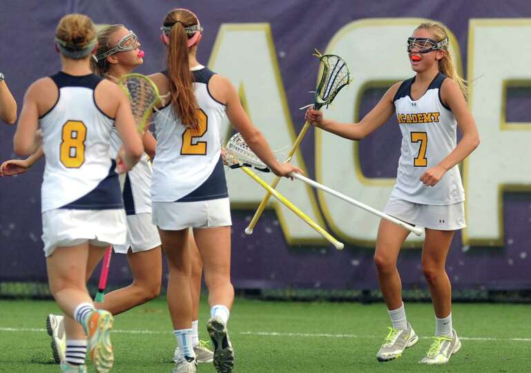 Albany Academy's Emma Malicki, right, is congratulated by teammates after scoring during their Secti