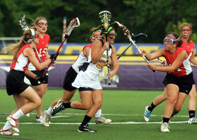 Albany Academy's Emily Martin tries to power by Emma Willard defenders during their Section II Class C girl's high school lacrosse final on Wednesday May 22, 2013 in Albany, N.Y. Albany Academy won 15-5. (Michael P. Farrell/Times Union) Photo: Michael P. Farrell