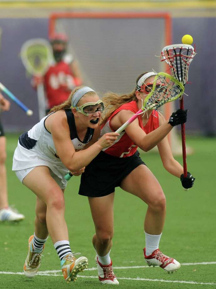 Albany Academy's Ellie Daly and Emma Willard's Xani Shultis battle for the ball during their Section II Class C girl's high school lacrosse final on Wednesday May 22, 2013 in Albany, N.Y. Albany Academy won 15-5.(Michael P. Farrell/Times Union) Photo: Michael P. Farrell