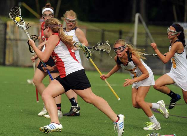 Emma Willard's Natalie Kiley-Bergan advances the ball during their Section II Class C girl's high school lacrosse final against Albany Academy on Wednesday May 22, 2013 in Albany, N.Y. Albany Academy won 15-5.(Michael P. Farrell/Times Union) Photo: Michael P. Farrell