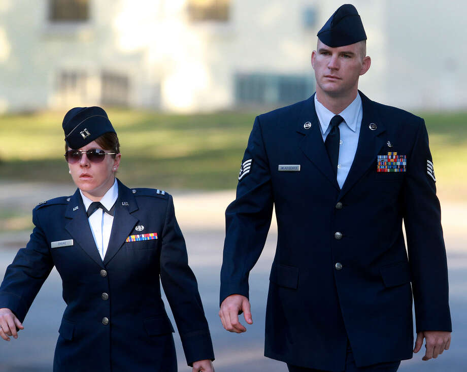 Capt. Lauren Shure, a defense lawyer, walks with Lackland basic training instructor Staff Sgt. Michael Wladischkin, who is accused of pursuing seven women in hopes of having sex. Photo: John Davenport / San Antonio Express-News